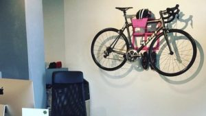 Pink all in one hanging system racing bike