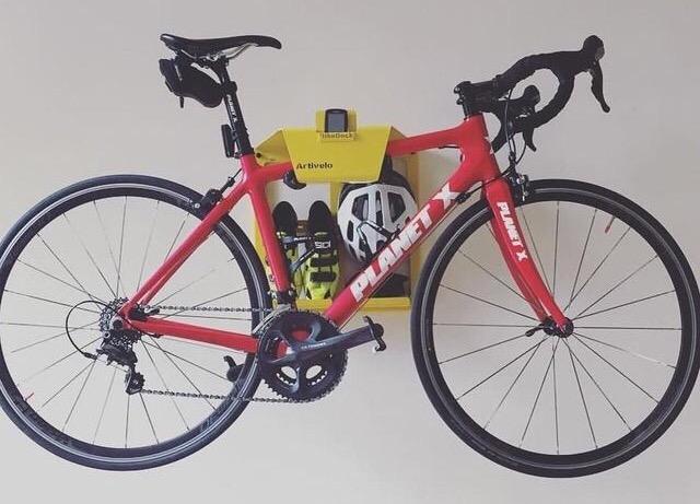 Yellow steel hanging system racing bike