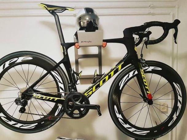 Grey steel hanging system racing bike