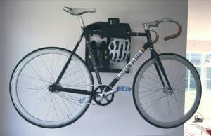 Black road bike hanging system on the wall