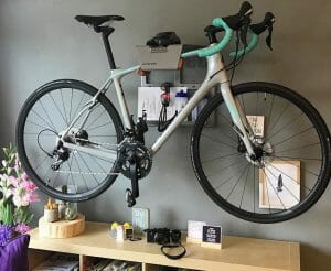 Grey road bike hanging system on the wall