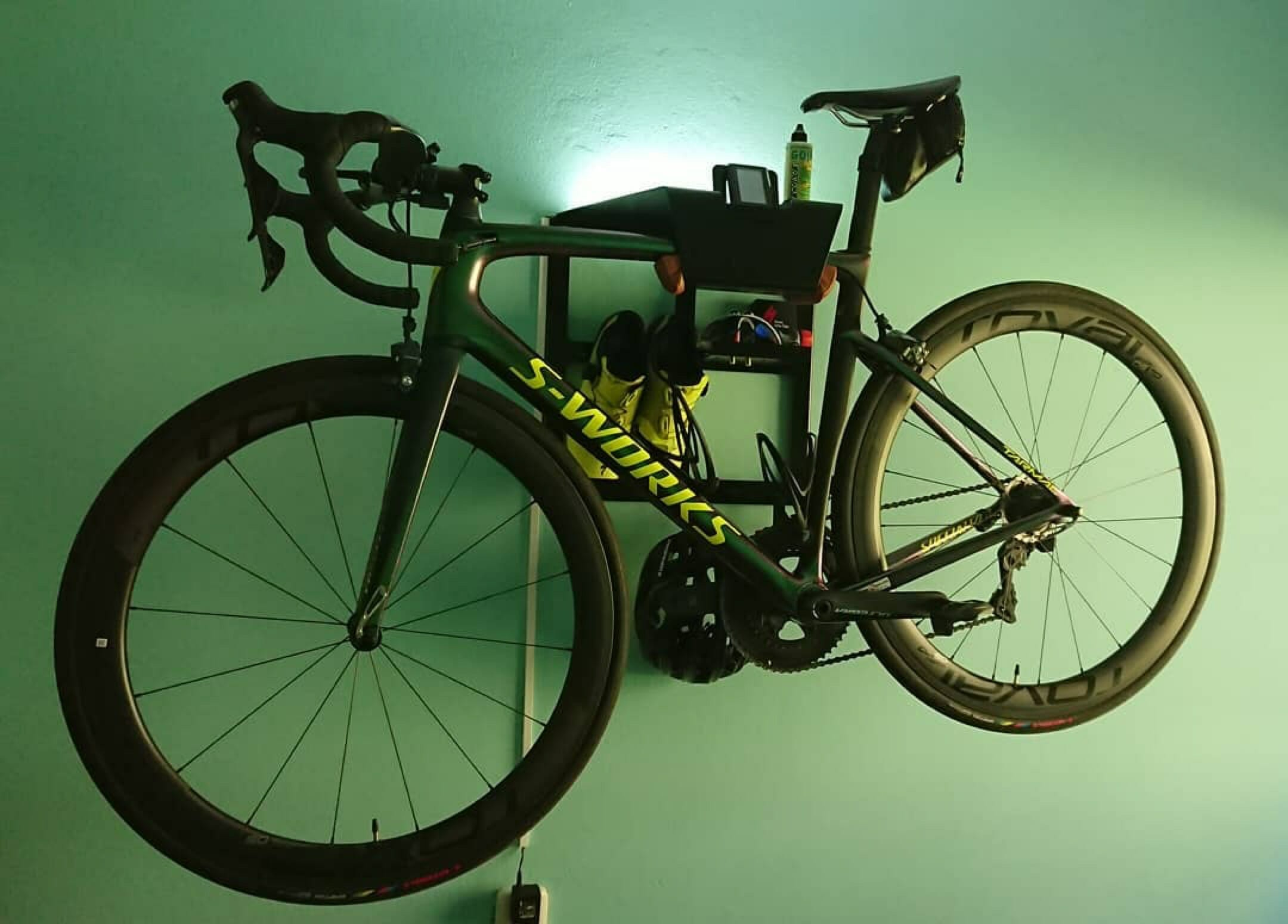 Hang up racing bike vertically black