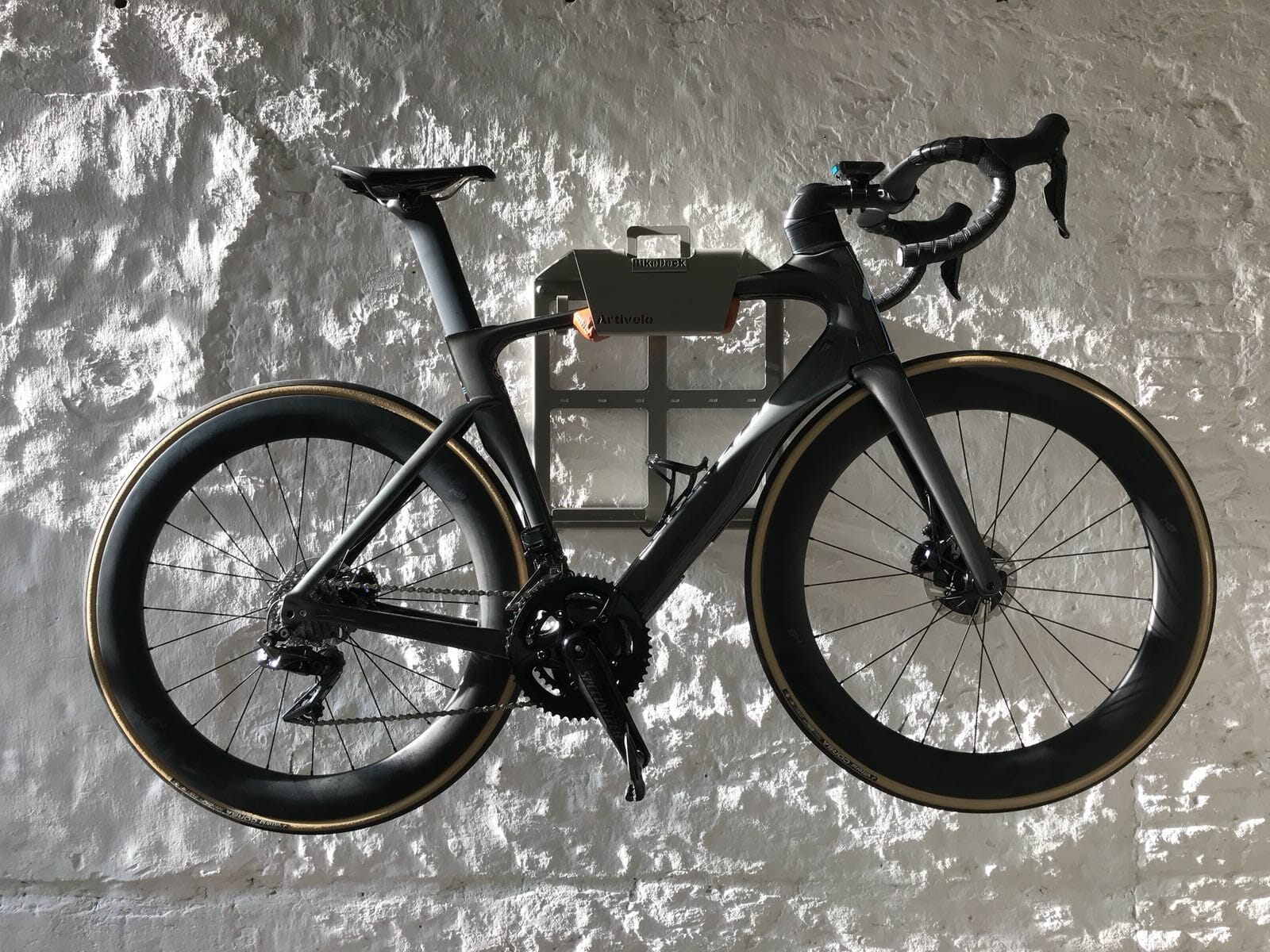 Bike storage solution on the wall grey