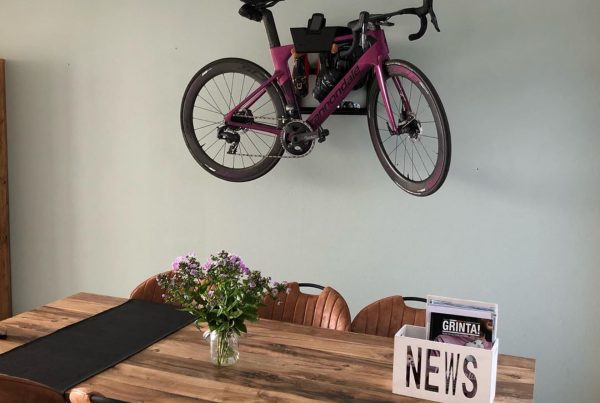 hanging up a racing bike in the living room